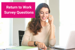 A woman is holding up the phone to her ear while she is working at a desk